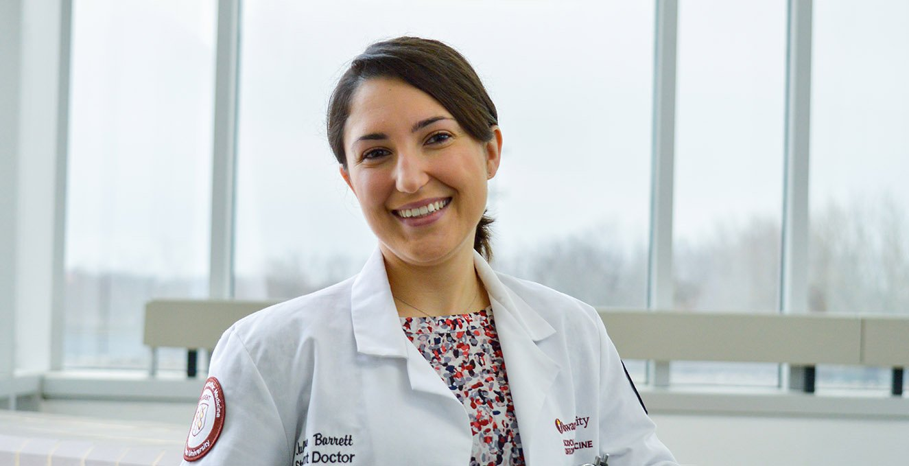 Fourth-year RowanSOM medical student, Julianne Barrett, on the third floor of the Atrium of the Academic Center.