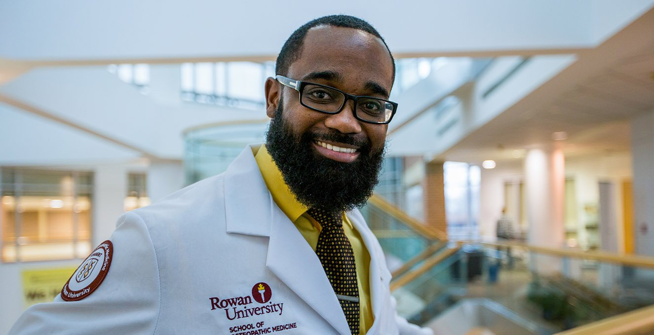 First-year RowanSOM medical student, DeSean Lee, smiles in the Atrium of the Academic Center.