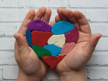a colorful heart in hands